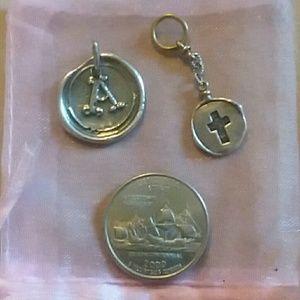 Waxing Poetic pendants or charms